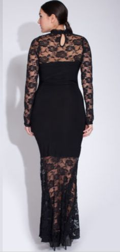 Long lace sleeves cover the arms and are so soft and comfortable. Black built in mini dress look is stunning. Lace mermaid bottom is so flattering and seductive. But...the embellishments on the front of the dress are GORGEOUS!!!!