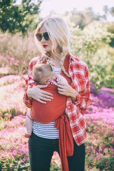 Barefoot Blonde Amber wearing Coral Solly Baby Wrap