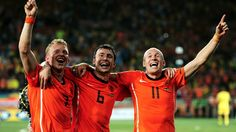 PORT ELIZABETH, SOUTH AFRICA - JULY 02: Mark Van Bommel (C) of the Netherlands celebrates victory with Dirk Kuyt and Arjen Robben following the 2010 FIFA World Cup South Africa Quarter Final match between Netherlands and Brazil at Nelson Mandela Bay Stadium on July 2, 2010 in Nelson Mandela Bay/Port Elizabeth, South Africa. (Photo by Laurence Griffiths/Getty Images)
