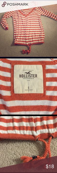 Hollister orange v-neck Great for all seasons, especially spring and fall due to its 3/4 sleeves. Has a perfect waist/hip tie at the bottom hem to help accentuate your figure and draw attention wherever you want it tied. Lovely scooping v-neck and soft material, though shows some piling (see close up photos). Lots of flirty fun here any time you wear it out.❤️🌸 I always received compliments in it. Hollister Tops