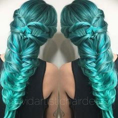 Long festival braided teal hair.
