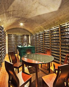 This custom built wine cellar has dozens of racks to hold a variety of wines, a tasting table, and a small sitting area as well.