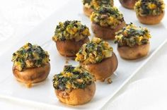 Spinach-Stuffed Mushrooms recipe - These simple, crowd-pleasing appetizers are so savory and flavorful, they'll be gone before you can explain they're low-fat.