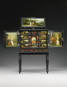 A Flemish ivory inlaid ebony, ebonised and tortoiseshell cabinet inset with painted panels, in the manner of Hendrik van Balen (1575-1632), Antwerp second half 17th century.