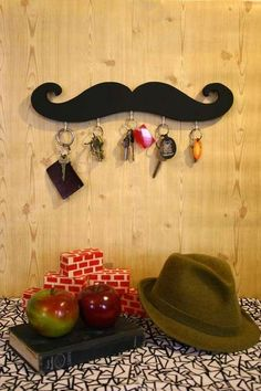 Mustache key hook with a thrift store grandpa hat and old book <3