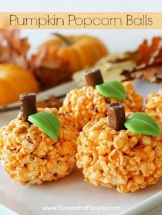 Pumpkin Popcorn Balls- easy treat for fall. I'm making these for my daughter's class party this year.