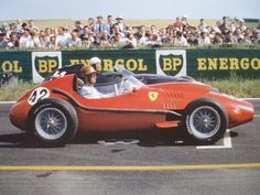 Peter Collins, Ferrari Dino 246, #42, (finished 5th) & Jean Behra, BRM P25, #14, (DNF-fuel pump), at start of French GP, Riems, 1958.
