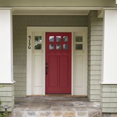 Fiery red makes dentil-molding details on a front door stand out for Craftsman-style curb appeal. @kellymoorepaint Eternal Flame (KM5471)