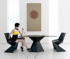 Gorgeous dining room set by Karim Rashid.