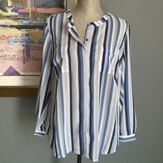 ✨SALE✨ Premise Studio Blouse Beautiful light weight blue multicolor striped button up blouse from Premise Studio .  Has two breast pockets and button closure sleeves .  Made of 100% polyester .  Machine wash/dry .  Tag size 0X which is equivalent to about a 16W .  ✨I have two of these available so please ask for a separate listing when ready to purchase✨ Premise Studio Tops Blouses
