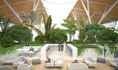 """The new lounge for the Pudong Airport in Shanghai is a jungle-like environment filled with a mix of trees, bushes and flowers. Italian firm Stefano Boeri Architects, the designers behind """"the world's first vertical forest"""", envisioned the space as an air-purifying device and a multi-functional area where passengers can relax and spend time while waiting for their flights."""