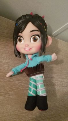 This Vanellope von Schweetz doll, from Disney's Wreck It Ralph, is in very good condition. Her head is hard plastic, the rest of her is plush. She is 12 inches tall. Disney Movies By Year, Disney Characters, Vanellope Von Schweetz, Wreck It Ralph, Disney Dolls, Plush, Rest, Plastic, Disney Princess