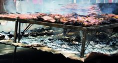 How to Master the Argentine Asado.  Although it's similar, it isn't done as a barbecue.