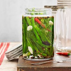 Spicy Pickled Green Beans -- With fall comes a bounty of beautiful vegetables. To get the most out of them all year long, preserve your favorites, like these bright and fresh green beans, in a spicy brine. #myplate #vegetables