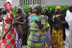 Schoolgirls who have escaped from Boko Haram kidnappers in the village of Chibok, arrive at the Government house to speak with State Governor Kashim Shettima in Maiduguri on June 2, 2014. Governor Shettima met with twenty-eight schoolgirls that escaped from Islamist abductors, their parents and also parents of more then 200 missing girls to seek ways of assisting them. Protests by supporters the schoolgirls have been banned in Nigeria's capital, Abuja, by the police on June 2. AFP PHOTO/STR…