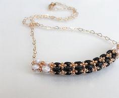 Modern Beaded Woven Tube Necklace in Gold Black by lizaluksenberg, $36.00