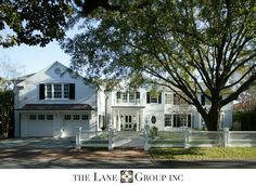 Florida coastal white house with black shutters by Lane Group, Inc. Residential Architecture, Architecture Design, Future House, My House, White Houses, Curb Appeal, Beautiful Homes, Building A House, House Plans