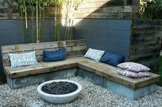 the mixture of stone and wood is great for a built-in seating area
