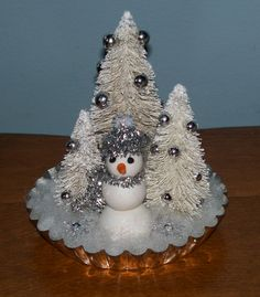 Christmas mixed media -- polymer clay snowman with bottle brush trees in a  tart tin.