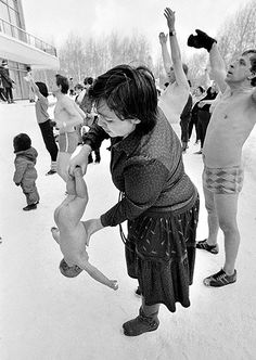 """The only info I could find on this picture was, """"Igor Charkovsky was a well-known person in Moscow with crowds of fans who wanted to have healthy kids."""" I'm not sure what that has to do with dangling a little baby naked in snowy Russia."""