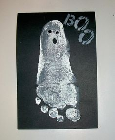 halloween decor with kid footprints... So cute for one day when I have kiddos!!!