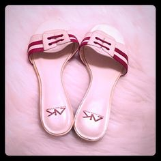 Anne Klein Sport Sandals Red and white leather stripe Ann Klein Sport slide sandals with tiny kitten heel. Cute, sporty, summery...wear with jeans, shorts, sundresses. Signs of wear on the bottom and minimal wear around the the edges, but good condition otherwise. Fun summer shoes! Anne Klein Shoes Sandals