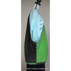 Zweifarbige Tasche aus Cord und kariertem Stoff.