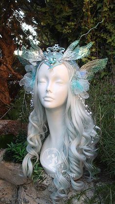 I was inspired to design a playful Water Sprite Headdress! A jewel encrusted crown connects two clusters of blue flowers and pearls at the sides of the head. Fabric and wire make double...