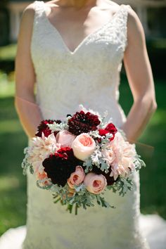 The bridal bouquet was a rich, textural array of burgundy and peach dahlias…