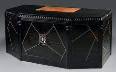 The large black-lacquer desk was designed by Jeanne Lanvin in the 1930s. This took pride of place at Andree Putman's loft in Paris