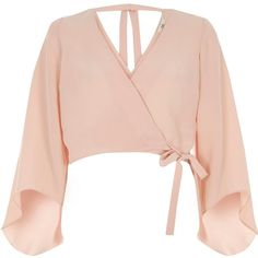 River Island Peitte pink wrap flare sleeve top (130 PEN) ❤ liked on Polyvore featuring tops, pink, blouses, women, flared sleeve crop top, woven top, bell sleeve tops, long tops and petite crop top