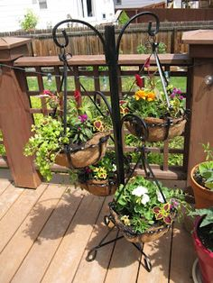 Plant stand makeover, and how to make cheap coconut grass basket liners.