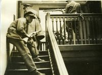 """Irish Free State Army on a building's stairs - From UCD Digital Library, Desmond FitzGerald Photographs, Photograph by W.D. Hogan """"Three Irish Free State Army members in offensive position on the stairs of a building, possibly a private house."""""""