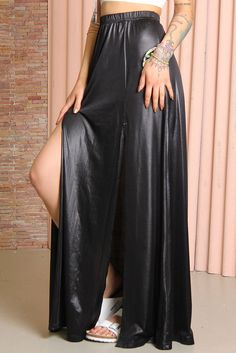 Maxi skirt by Somedays Lovin, made from a black stretch fabric with thogh-high splits to the front. Cool and casual piece with elasticated waistband and relaxed fit.