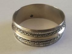 Silver Plated Decorated Bangle  Dimensions +/- :  7cm  diameter x  7cm width x 5cm width     Weight +/- :  34 g total