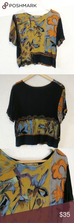 Vintage Artsy 80s 90s Grunge Streetwear Top Shirt Vintage late 80s, early 90s top by Young Trends by Papillon.  Has yellows, grays, blues, oranges, browns, purples & black. Has floral like patterns and filagree in a brush strokes like print.  Each sleeve has blocks of color: on one the front is colored and the back is black, on the other it is the opposite.  Has exposed, decorative orange serging near the bottom hem.  Has short slits on each side on the bottom.  Hems have some purposeful…