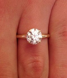 this is still my favorite ..... 1.00 CT ROUND CUT D/SI1 DIAMOND SOLITAIRE ENGAGEMENT RING 14K YELLOW GOLD