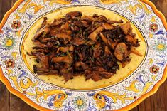 Sherried Wild Mushrooms with Creamy Parmesan Polenta - I think I'm going to try this with beef tips or brisket since I don't like mushrooms