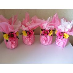 centerpieces. any sort of cup or vase wrapped in tissue paper could work. Baby Shower Cake Pops, Baby Shower Cupcake Toppers, Baby Girl Shower Themes, Baby Shower Table, Baby Shower Balloons, Baby Shower Parties, Baby Shower Gifts, Christening Centerpieces, Baby Shower Centerpieces