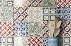Country Patchwork is a wall tile. They have combinations of different colored tiles varying from box to box. The tiles have a polished finish. The patchwork pattern is created by geometric patterns and colors. Country Kitchen Tiles, Kitchen Wall Tiles, Ceramic Wall Tiles, Bathroom Wall, Colourful Kitchen Tiles, Sage Kitchen, Patchwork Kitchen, Patchwork Tiles, Linda Barker