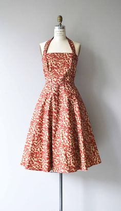 Vintage 1950s cotton dress with red budding floral print on a subtle golden metallic background. Princess seamed, halter neckline, fitted waist and full skirt. Back zip closure. --- M E A S U R E M E N T S ---  fits like: medium bust: 36-37 waist: 30 hip: free length: 37 from top of bust brand/maker: n/a condition: excellent  to ensure a good fit, please read the sizing guide: http://www.etsy.com/shop/DearGolden/policy  ✩ layaway is available for this item  ...