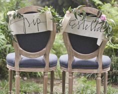love this simple wild decor for bride & groom chairs
