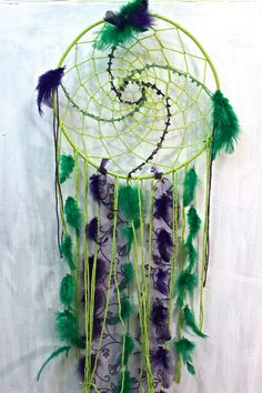 """""""Spiral union""""dreamcatcher with aventurine and amethyst made by a Vancouver Island artist www.suzannart.com #dreamcatcher #green #purple #crystal #feather #dream #goodvibes #suzannart #spiral #fibonacci Vancouver Island, Spiral, Dream Catcher, Feather, Amethyst, Crystals, Purple, Green, Artist"""