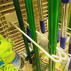 Many items hung on Double-Arm Utility Hooks might not need bottom restraint, but some would benefit from this Broom Hook Bottom Retainer on Grid. Whisk Broom, Mops And Brooms, Hooks, Grid, Retail, Concept, Shops, Retail Merchandising, Wall Hooks