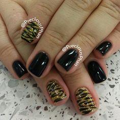Black and gold zebra nails