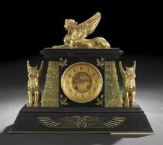 French Egyptian Revival Gilt-Bronze-Mounted, Incised Marble and Onyx Mantle Clock, fourth quarter 19th century
