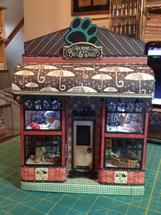 This is one of Laura Denison Designs Maple Street Shop Series. This is the Pet shop and I used Graphic 45 Raining Cats & Dogs paper