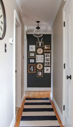Cute photo wall gallery for upstairs hallway near large bedroom. Style At Home, Upstairs Hallway, Long Hallway, Dark Grey Hallway, Dark Grey Feature Wall, Hallway Art, Flur Design, Hallway Designs, Deco Design