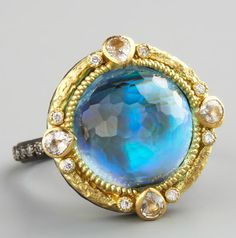 Midnight Round Ring by Emily Armenta. Intensely faceted, round mother-of-pearl and blue topaz doublet face; 7.69 total carat weight. 18-karat yellow gold bezel. Round-cut white diamonds and pear-cut white sapphire. Oxidized sterling silver backing and band, circa 2012