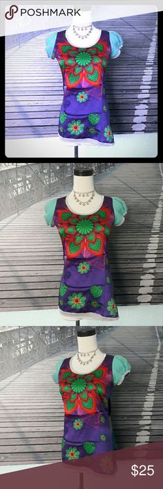 "CUSTO BARCELONA funky mixed-media top, sz 2-4 Sadly have to re-posh, as the lamé trim around the sleeves is too tight for my oversized arms. Stunning top in EUC, no flaws to note. Silky polyester panel with vibrant floral print in the front, striped knit in the back. Silver lamé trim. The back has stretch, the front does not. Cute cap sleeves. Slightly assymmetrical hemline. Spanish size 1 is a US S, best for sz 2 or 4. Measurements taken flat and unstretched: 16"" bust, 14.5"" waist, 25""…"